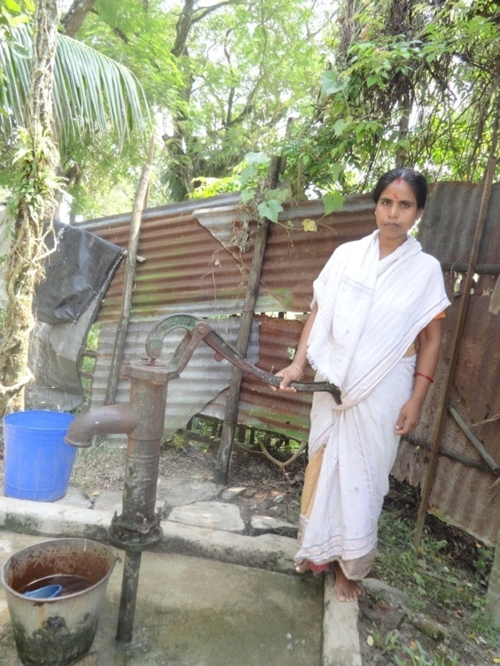 Rupali at the tubewell at her house