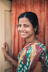 Usha smiling over her shoulder at the camera
